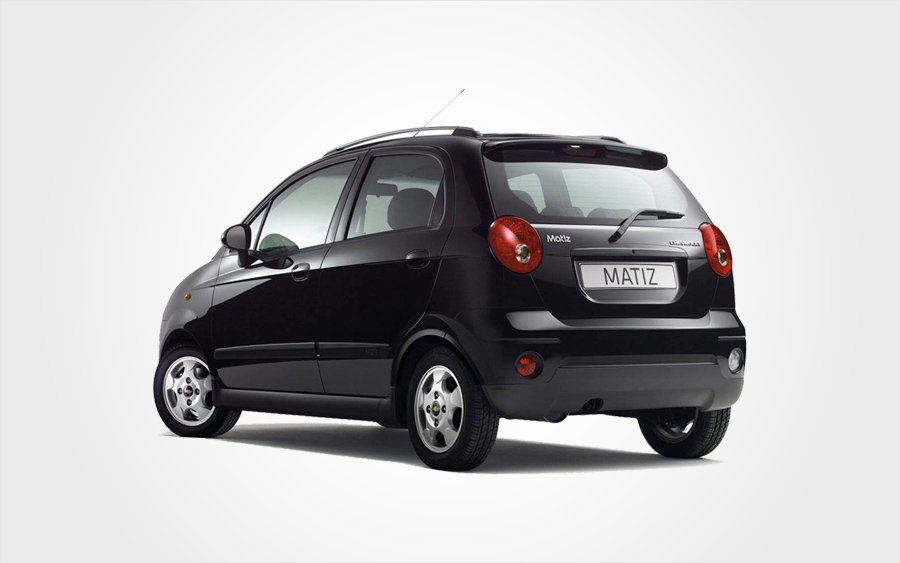 Rear of black Chevrolet Matiz economy small car. Reserve a Europeo Cars rentals group A car in Crete