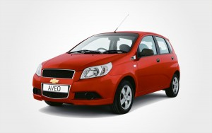 Chevrolet Aveo rental car in red. With Europeo Cars you can reserve a cheap Group C car in Crete.