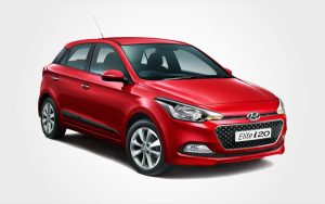 Hyundai Elite i20 rental car in red. With Europeo Cars you can reserve a Group C car in Crete.